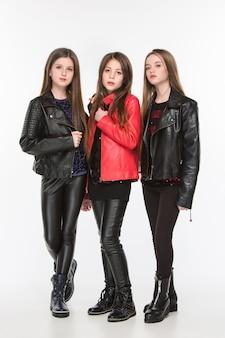 Portrait of young attractive caucasian teen girls posing