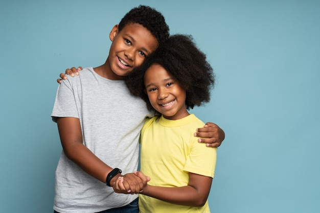 Portrait of young attractive family couple of brother and sister in casual wear standing together