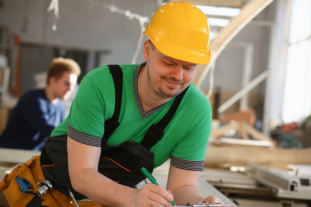 Portrait of young attractive man in work