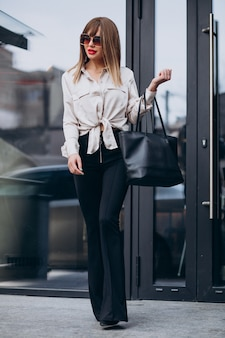 Portrait of young attractive woman model wearing balck trousers