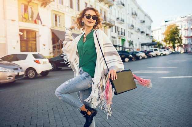 Portrait of young attractive woman in sunglaases, street style fashion, bohemian elegant