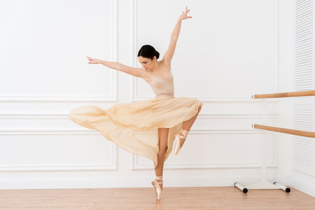 Portrait of young ballerina dancing