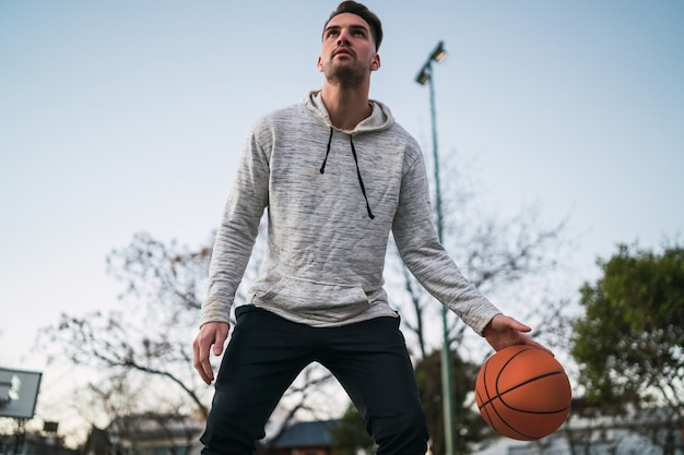Portrait of young basketball player playing outdoors. sport concept. basketball concept.