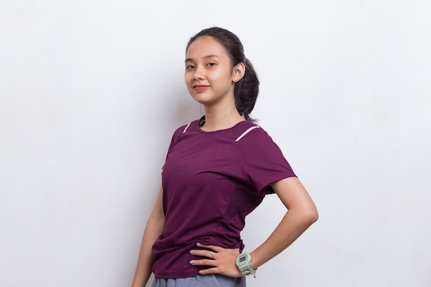 Portrait of young beautiful asian sport woman on white background