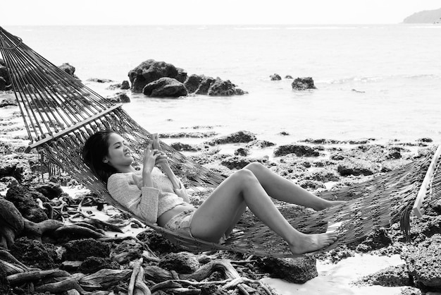 Portrait of young beautiful asian tourist woman relaxing at the beach in thailand