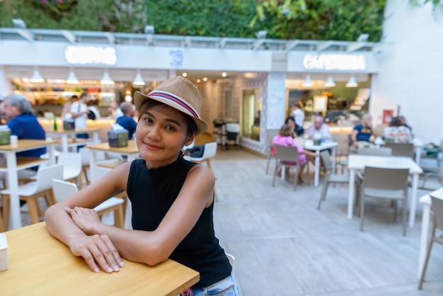 Portrait of young beautiful asian tourist woman at the restaurant outdoors in spain
