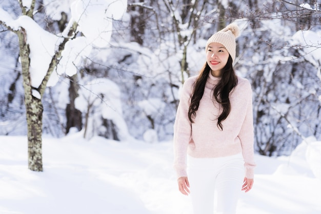 Portrait young beautiful asian woman smile happy travel and enjoy with snow winter season