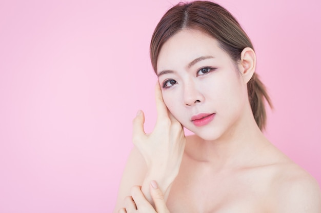 Portrait of young beautiful asian woman touch her clean fresh skin face.