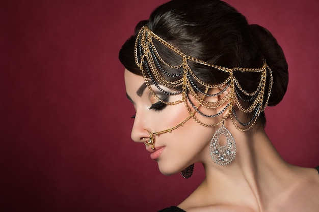 Portrait of young beautiful asian woman with evening makeup wearing head accessories