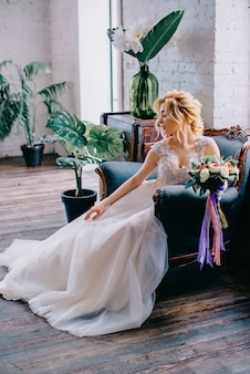 Portrait of a young beautiful bride in the interior