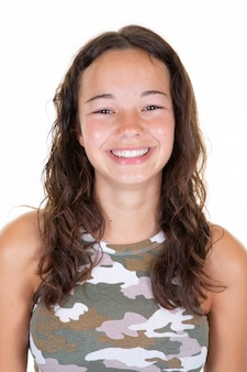 Portrait of young beautiful caucasian teenage in army t-shirt cheerfuly smiling looking camera in studio photo isolated on white background