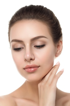 Portrait of young beautiful caucasian woman touching her face isolated. cleaning face, perfect skin.