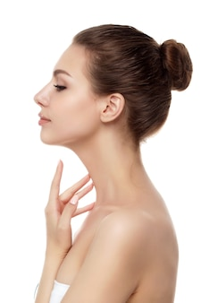 Portrait of young beautiful caucasian woman touching her neck isolated. cleaning skin, spa therapy, skincare, cosmetology