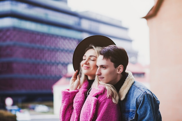 Portrait of a young beautiful couple on the background of the city