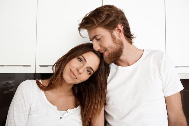 Portrait of young beautiful couple smiling