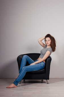 Portrait of young beautiful girl brunette in the studio