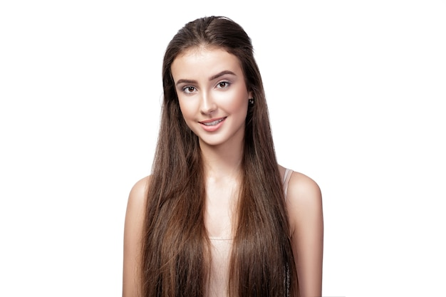 Portrait of young beautiful happy woman with long hair isolated on white background.