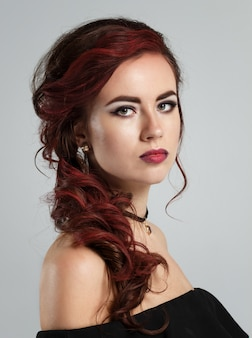 Portrait of a young beautiful red haired caucasian woman