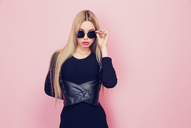 Portrait of young beautiful slim sexy young blonde woman in blac