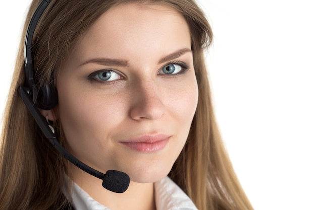 Portrait of young beautiful smiling call center worker talking to someone. smiling customer support operator at work