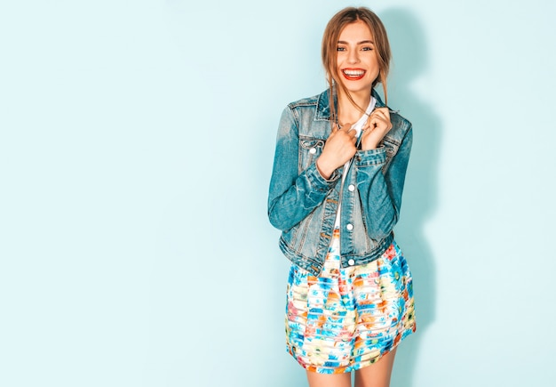 Portrait of young beautiful smiling hipster girl in trendy summer jeans jacket clothes.