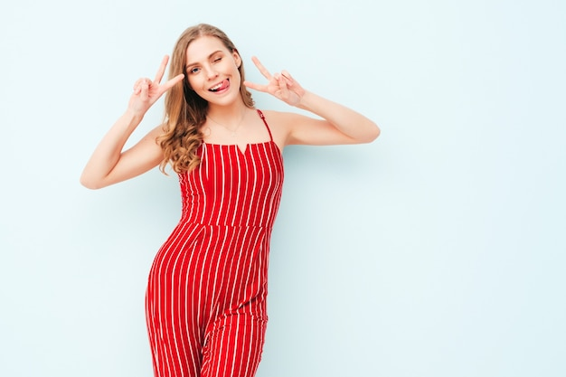 Portrait of young beautiful smiling woman in trendy summer red suit clothes