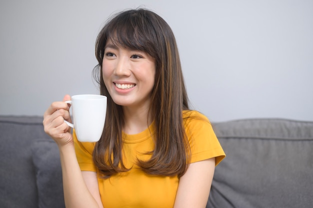 A portrait of young beautiful woman having a cup of coffee