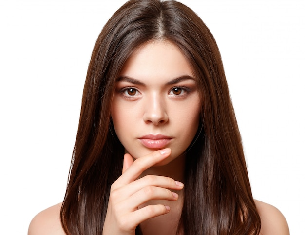 Portrait of a young beautiful woman with brown eyes