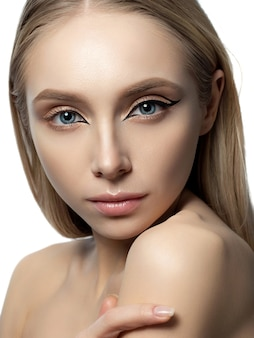 Portrait of young beautiful woman with modern fashion asymmetric eyeliner wings.