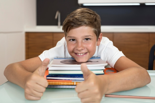 Portrait of young boy smiling at home