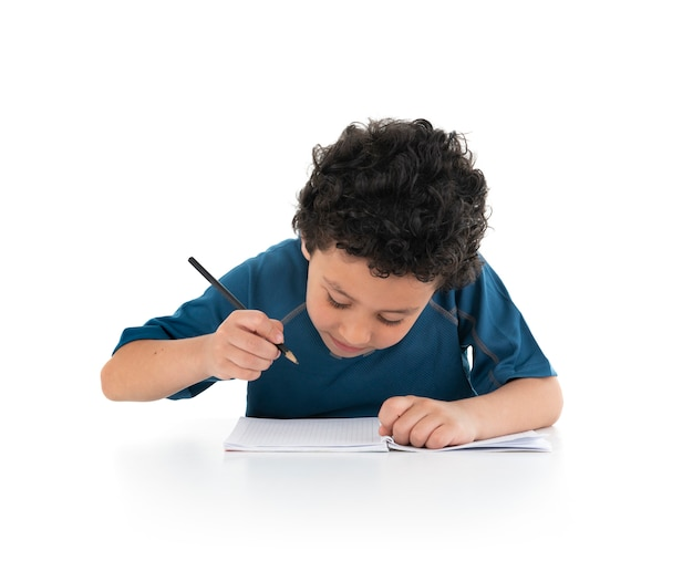 Portrait of young boy studying and doing on white background