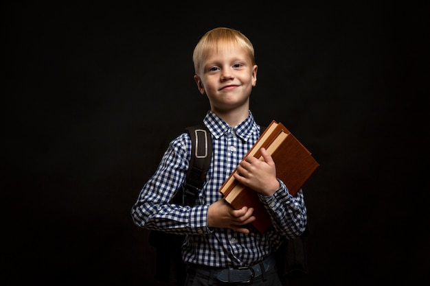 Portrait young boy studying