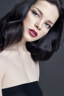 Portrait of young brunette woman makeup. hair care