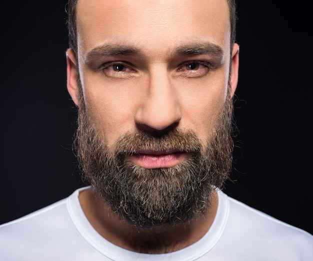 Portrait of a young brutal man with full beard.