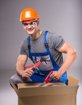 Portrait of a young builder with tools in hand to build.