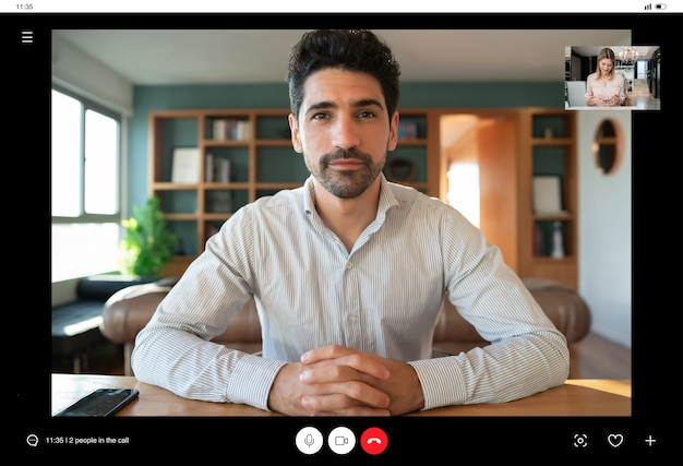 Portrait of young business man on a work video call while staying at home.