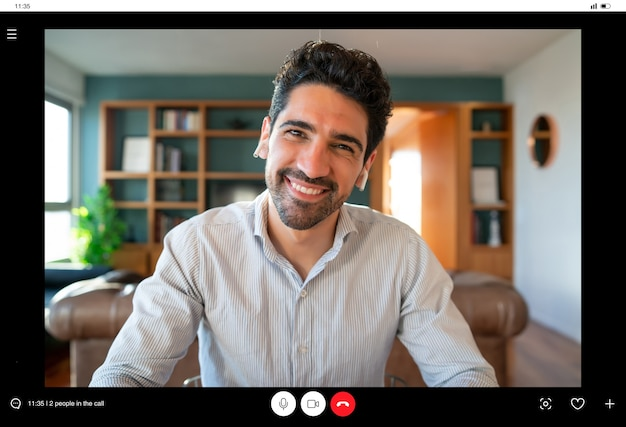 Portrait of young business man on a work video call while staying at home