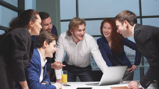 Portrait of young business team at work. bright contemporary small creative business.