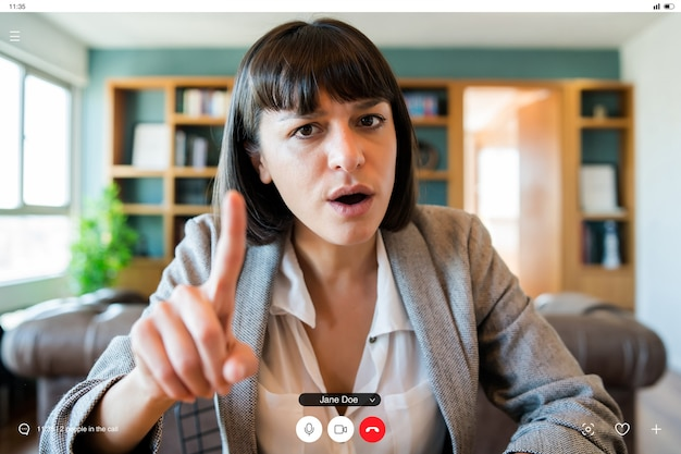 Portrait of young business woman on video call from home.
