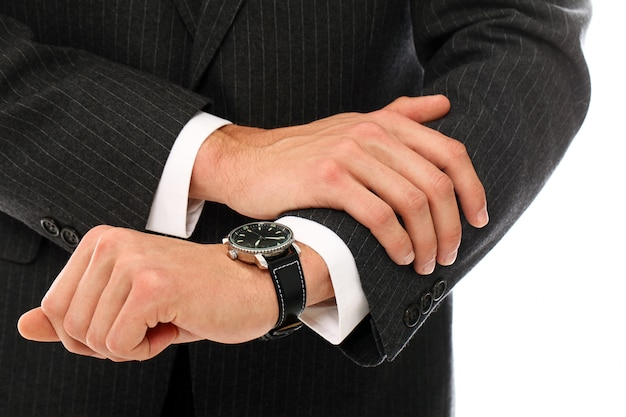 Portrait of young businessman, hands close up