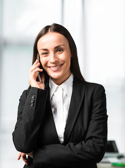 Portrait of young businesswoman talking on smartphone
