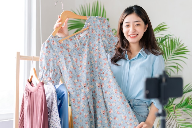 Portrait of a young businesswoman who is broadcasting live selling clothes