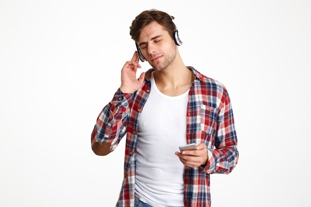 Portrait of a young casual man in headphones