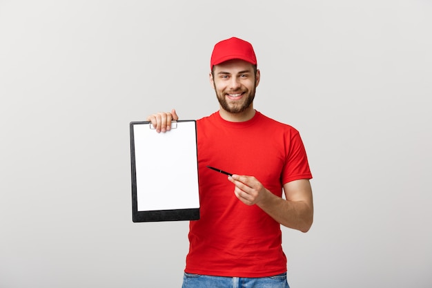 Portrait young caucasian delivery man or courier showing a confirmation document form to s