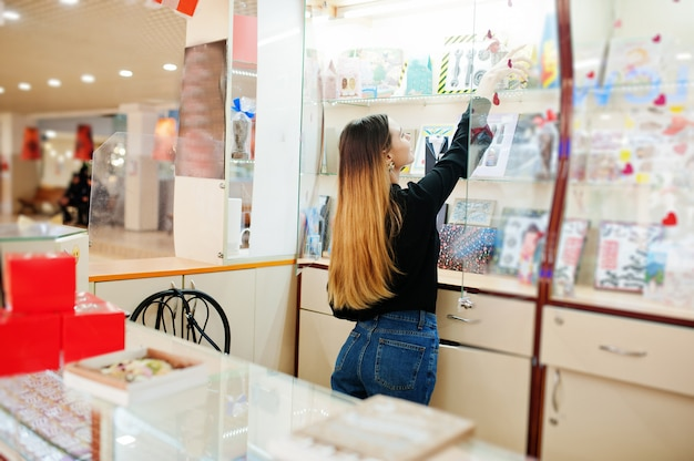 Portrait of young caucasian female woman seller. small business of candy souvenirs shop.