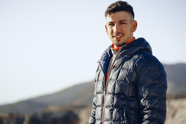 Portrait of a young caucasian man hiking in the mountains