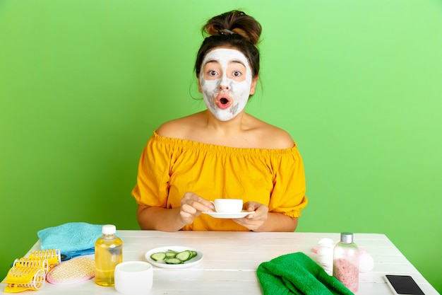 Portrait of young caucasian woman in beauty day, skin and hair care routine.