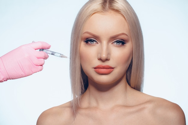 Portrait of young caucasian woman.  of botox cosmetic injection