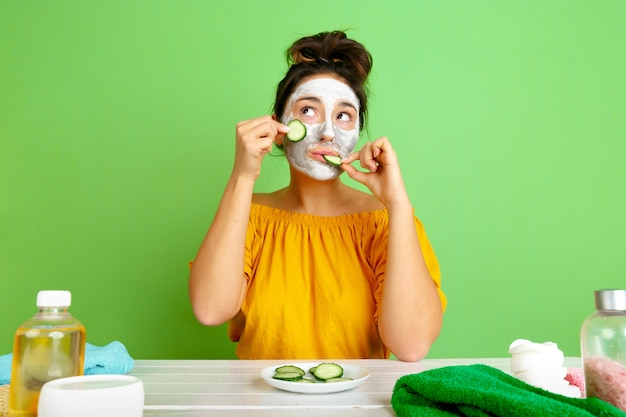 Portrait of young caucasian woman in her beauty day, skin and hair care routine