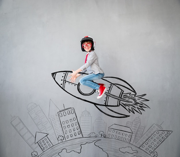 Portrait of young child pretend to be businessman. kid playing at home. success, idea, and creative concept. copy space for your text